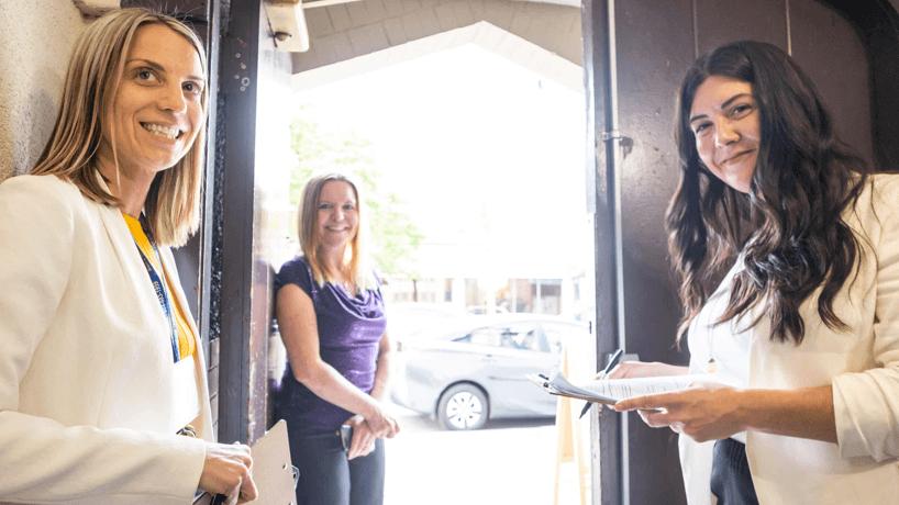Staff welcoming people at SJMA doors